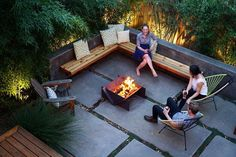 Urban design:  floating bench, Acapulco chairs, Stahl Firepit, concrete wall and paved patio, black bamboo   www.stahlfirepit.com