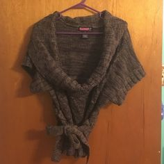 Brown Cowl Neck Sweater Brown cowl neck sweater with tie at the waist. Fits a large comfortably. EUC no trades Sweaters Cowl & Turtlenecks