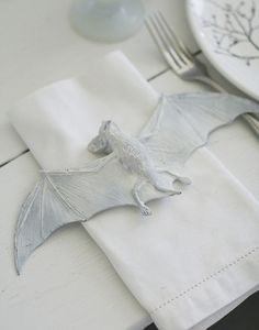 White Painted Bat Napkin Setting | 24 Beautiful And Stylish Ways To Decorate For Halloween