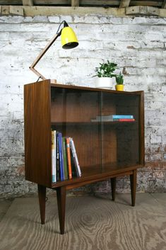 1960s Richard Hornby Afromosia bookcase. (I have a smaller, knock off version in my house, it only has three good legs...)