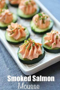 An easy recipe for smoked salmon mousse made with cream cheese and piped on cucumber slices. It's an easy recipe that produces impressive results.