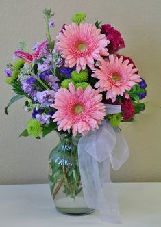 Spring time flowers accented with a butterfly by Willow Branch Florist of Riverside