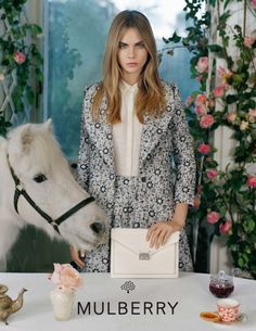 Cara Delevingne poses with animals (again) for Mulberry