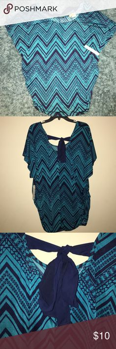 NWT LAVISH Plus Blue Patterned Blouse - Size 3X This 3XL Blue Patterned Lavish Plus Blouse is super light weight & comfortable. This item is new with tags & is created with 92% polyester & 8% spandex. Can be wormed causal & can also be styled for the business woman looking to add pop to her wardrobe. Lavish Plus Tops Blouses