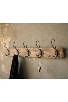 "With rustic charm and functionality, this recycled wooden coat rack offers vintage and nautical style. Hold your keys, bags, and coats next to your entry way while adding a layer of antique-inspired texture. 26"" x 5½""t"