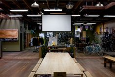 Large community tables and customer engagement pieces - screen for movie nights, band stage, etc.