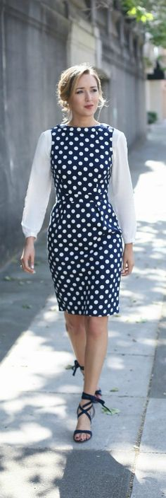 navy polka dot sheath dress, ivory blouse, tie up heels, pearl earrings + messy bun hairstyle {boden}