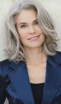 Hairstyles For Women Over 50 - Platinum Bob With Wavy Bangs