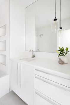 Compact contemporary white and gray bathroom features Arctic White lacquer finish flat-panel base cabinets with handles.   Model: Snaidero CODE Location: Arlington, Virginia Designer: Shawna Dillon of Studio Snaidero DC Metro #SnaideroUSA
