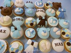 Christening cupcakes - these were made to accompany the main cake so the colours matched perfectly — by Cakesby Carol.