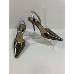 Michael Kors Metallic Brown Pointed Toe Slingback Sandals Heels Size 9 M $340 minor wear from being tried on and kept on shelf original box not included  Please note that clothing items may fit differently due to Brand, Fit, Use or Prior customization. We strongly urge you to check the measurements above to guarantee proper fitting. This is from a smoke free home. Color may differ slightly from the color shown in the photo due to lighting. Photos shown are of actual item. Please examine… Michael Kors Sandals, Slingback Sandal, Clothing Items, Color Show, Shelf, Metallic, Smoke Free, Toe, Lighting