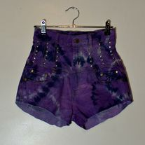Amazing vintage high waisted shorts!! Purple tie-dye pattern.  Waist cincher styled at the top.  Single row of small pyramid studs going down each front panel. Two studded crosses on the back panels.  Stretch demin.    Size 10AUS/8US