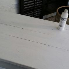 Painting an antique library table with L'essentiel Botanics Furniture paint color called Pure White. Fabulous coverage with just one coat!