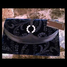 Monzo & Franco velvet purse This purse can be used with a beautiful gown or outfit for that special prom or event. The purse is navy blue and has a sparkly paisley design with a rhinestone pendant and a magnetic fastener. Inside has a satin fabric. It has only been used twice. Bags