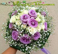 Buchet mireasa Buchet mireasa alcatuit din trandafiri lila si tros crem  Pret: 200 RON