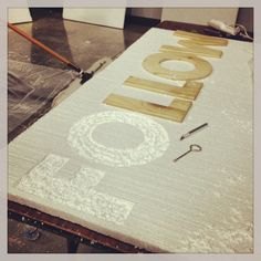 Using foam and wooden letters to carve messages for the church art installation.