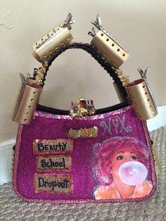 6051715b25 Beauty School Dropout 2015 NYX purse. Front side.
