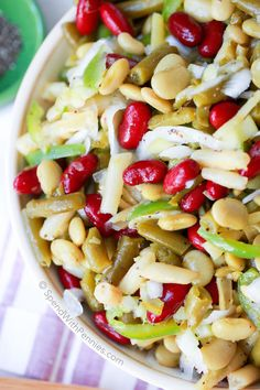 This Old Fashioned Bean Salad has been a family staple for years. 4 kinds of beans and a hint of white onion all dressed in a sweet tangy vinaigrette dressing. This is the perfect make ahead side salad for any get together or BBQ!