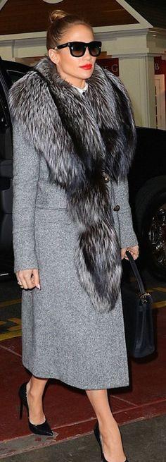 Who made Jennifer Lopez's black tote handbag, pumps, and gray coat? Coat – Roberto Cavalli Purse – Valentino Shoes – Casadei