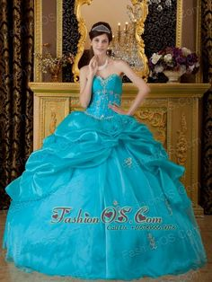 Popular Teal Quinceanera Dress Sweetheart  Organza Appliques Ball Gown  http://www.fashionos.com  An elegant pretty quinceanera gown features a sweetheart neckline bodice and a ruffled skirt. Beaded appliques decorates the bodice and the gall to add the shinning and delication of the dress. The ruched bustline create a flattering silhouette.The gown accent a ruffle out layer and a smooth inner layer.