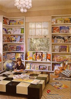 Kelly Wearstler kids library.    How fun would it be to turn a wall in your kid's room into a library-esque reading space!