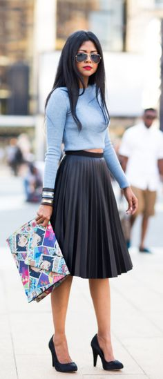Black pleated midi skirt + Sheryl Luke + cute cropped sky blue sweater + matching black heels.  Top/Skirt: Topshop, Shoes: Coye Nokes, Clutch: Elisabeth Weinstock, Cuff: Sibilia.