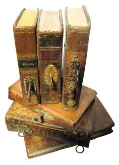 key holes and keys on the spines of old books...what secrets do they hold???