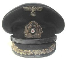 Reproduction German Kreigsmarine Korvettenkapitän Peaked cap. This cap has been made to look worn but in very good condition and to look 70+ years old. It is a size 57.   www.warhats.com