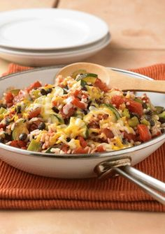 Zucchini combined with black beans, fire roasted tomatoes and rice for an easy skillet recipe!