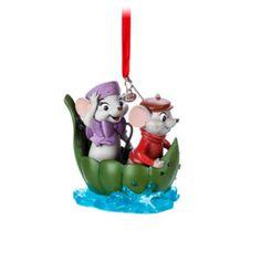 Feiere mit diesem süßen Bernard und Bianca Dekorationsstück den 40. Geburtstag eines beliebten Disney Klassikers. Die Kunstharzfigur zeigt Bernard und Bianca in ihrem berühmten Blattboot.