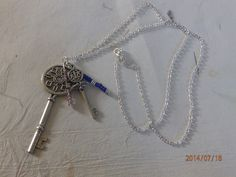 Silver vintage keys with glass beads and cube metal spacers on an 30 inch chain £6.00