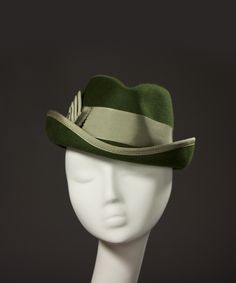 Tricia Roush writes about her business House Nines Design, the history of hats and hat making, hat and fashion news, etc.