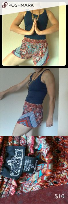 Angie Flowy Shorts Wide elastic waistband, lightweight flowy material, vibrant colors and trippy design. Tag says Large, but I assume that's Juniors sizing because I am a small/4 and these fit great! EUC. Angie Shorts
