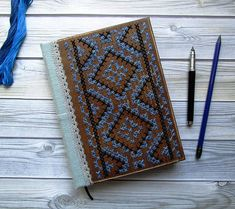 Wooden book with handmade embroidery technique on wood | This handmade journal is bound using coptic binding, has 100 sheets | Page-aged coffee and very nice smell
