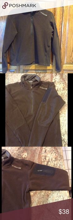 "NWOT Men's Columbia Chocolate Brown 1/2 Zip Fleece This cozy men's pullover is in pristine condition. Never worn. Features 1/2 zip front, and zipper pocket on left sleeve. Subtle quilted patch detail on the elbows. Laying flat, measures 21"" armpit to armpit. Measures 24"" top of shoulder to bottom. Sleeve measures 21"" under armpit to end of sleeve. Columbia Titanium brand. Men's medium. Columbia Sweaters Zip Up"