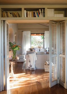 Utilizing louvered shutters as a room divider. Would be stunning if they were finished as vintage shutters. Louvre Doors, Louvered Shutters, Indoor Shutters, My New Room, Home And Living, Home Projects, Small Spaces, Living Spaces, Living Room