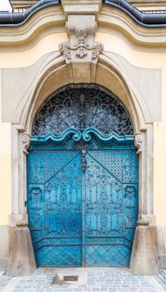 door... Wroclaw, Poland. Amazing color and decorative iron work!
