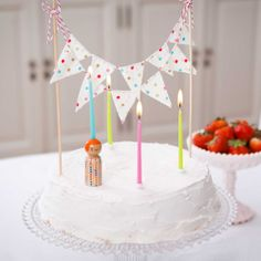 CAKE WITH CANDLES AND BUNTING