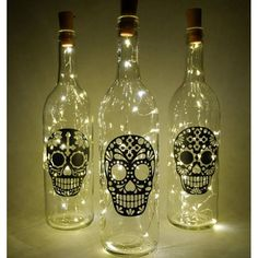 Decorate your home with this beautiful set of light-up glass bottles. The bottles have been finished with my hand made vinyl decal artwork. If youd like to mix-and-match with any of the other bottle designs listed on my store, please leave me a note when checking out. Love this design?