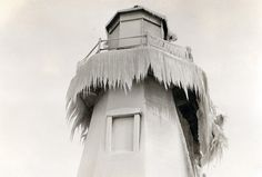 Winter shots at the beach strip. This image shows the lighthouse at the end of the pier in Lake Ontario.