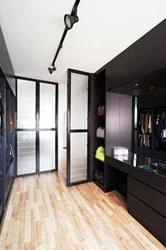 he steel-and-glass louvres of the partitions in the master bedroom separate the walk-in wardrobe area from the rest of the bedroom.