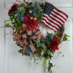 Display your patronage from my Patriotic Collection, Patriotic 4th of July wreath by Gaslight Floral Design. GaslightFloralDesign.com #patrioticwreath #americawreaths #4thofJulywreaths