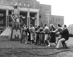 1947 University of Minnesota Homecoming Committee raising the big Gopher statue in front of Coffman Memorial Union.