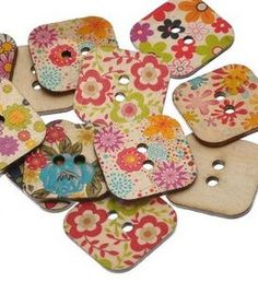 Square classic wooden buttons with flower designs.