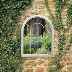 mirror on garden wall