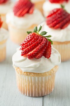 Angel Food cupcakes with whipped cream for icing and strawberry garnish