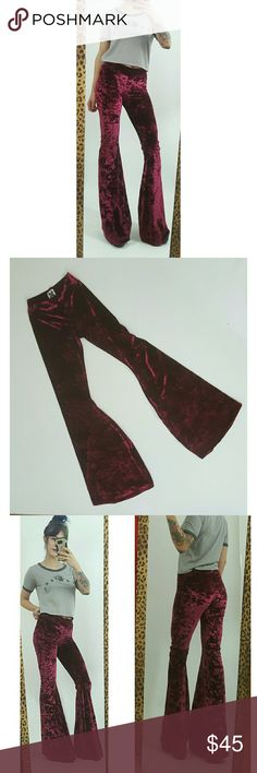 "Burgundy Maroon crushed velvet flare bellbottoms Throw back to a staple in 70s style with these maroon crushed velvet bell bottom pants from Castles Couture. These retro look velvet bells are made of a soft, stretchy material for a flexible and legging-like fit. High elastic waist, no closure.   90% Polyester, 10% Spandex. 100% vegan made material.  Waist 26-29"" around.  Length 46.""  Inseam 37."" castles couture Pants Boot Cut & Flare"