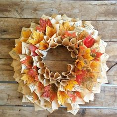 Make your own Fall Wreath for less than $3, by using an old book and faux leaves!