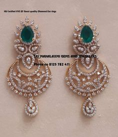 Stunning gold chaandbali studded with diamonds and emeralds. Presenting here Diamond Ear rings. Contact no 8125 782 20 March 2019 Diamond Earrings Indian, American Diamond Jewellery, Diamond Earing, Diamond Jewelry, Diamond Jhumkas, Jewelry Design Earrings, Gold Earrings Designs, Gold Jewellery Design, Tika Jewelry