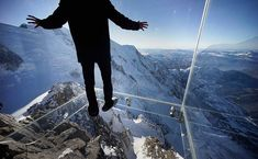 "Atop the 12,600 foot Aiguille du Midi peak is a glass cage named ""Step into the Void."" Visitors enjoy the view of Mont Blanc, Europe's highest mountain, from what is the world's highest glass floor."